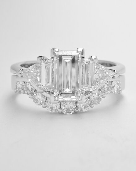 A platinum 9 stone part channel set round brilliant cut diamond wedding ring shaped to fit around a 5 stone baguette & triangle cut diamond ring.