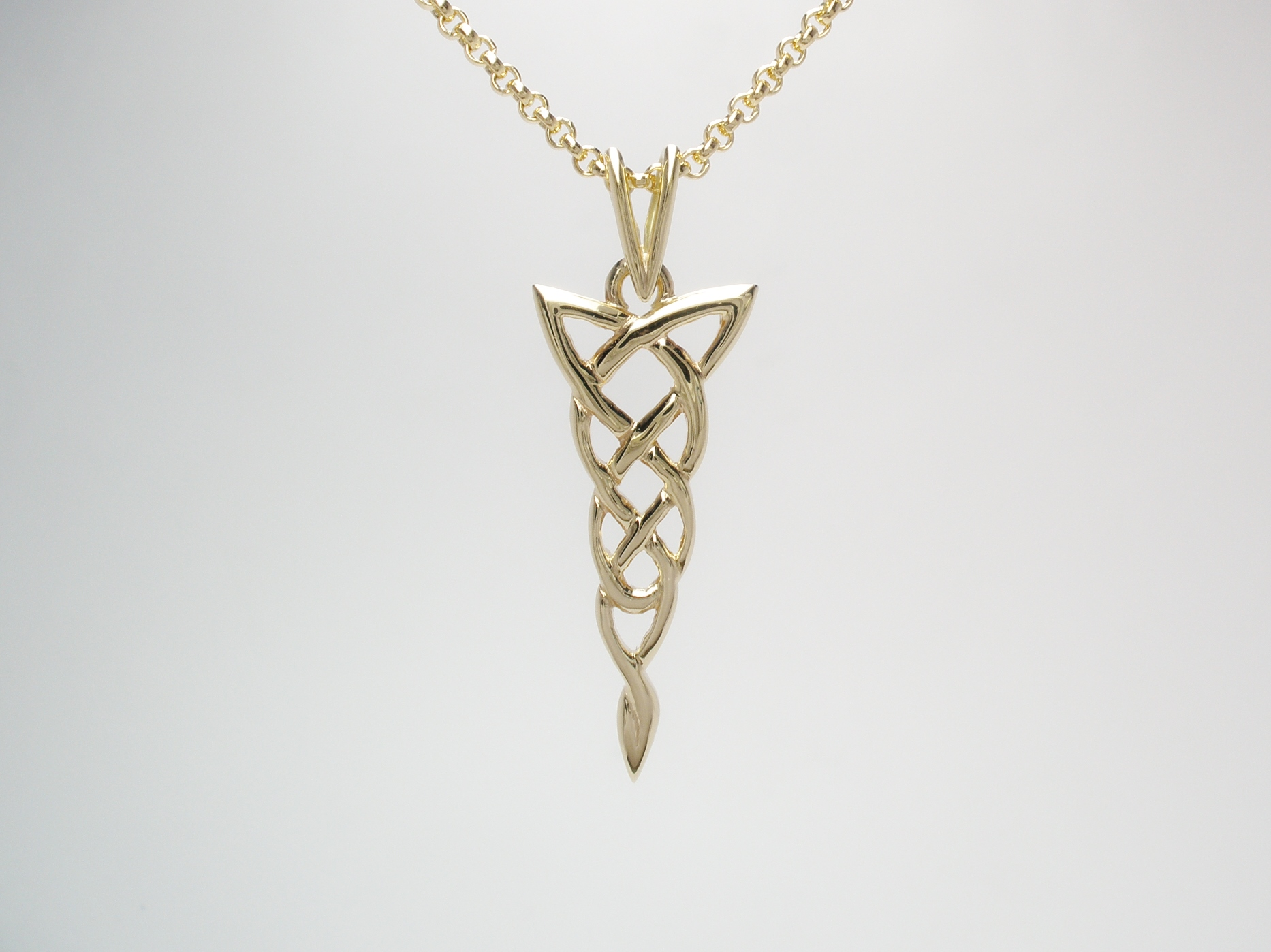 A 9ct. hand carved Celtic pattern pendant.