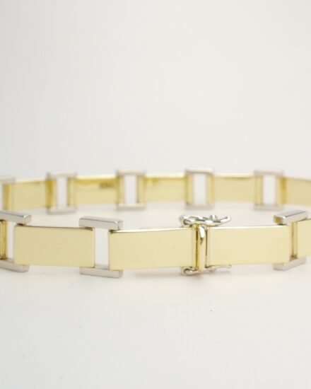 9ct gold and platinum panel bracelet with 9ct gold box catch and a pair of platinum figure 8 safety catches.