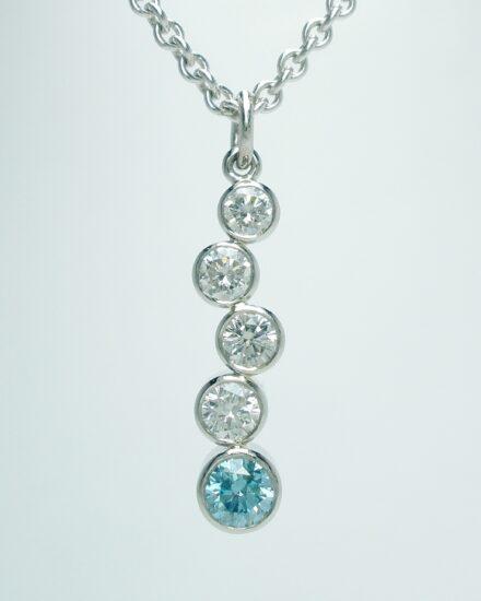 5 stone sky blue and white round brilliant cut diamond tumble pendant rub-over set in platinum
