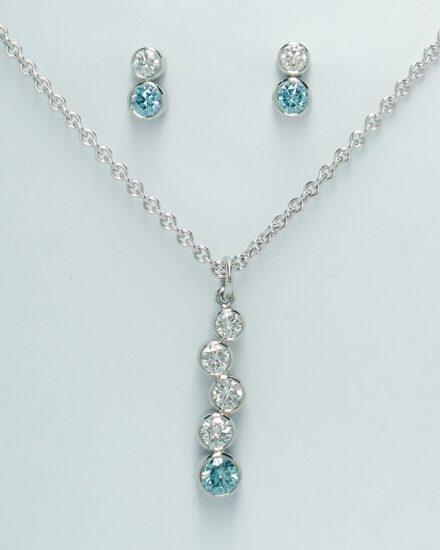 The 5 stone sky blue and white tumble pendant along with the complimenting 2 stone sky blue and white diamond ear studs