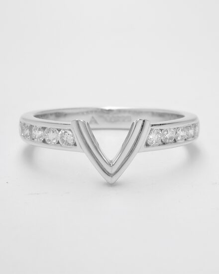 A 10 stone channel set round brilliant cut diamond ring shaped with a central double 'V' wire to fit with a marquise diamond engagement ring.