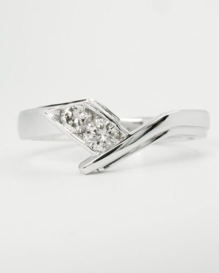 The 2 stone shaped diamond ring created finer and with more style and finesse. The engagement and wedding ring together both with more style and finesse showing of the diamonds far better.