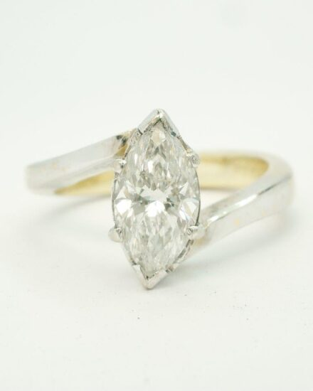 Single stone marquise cross-over ring showing the very untidy way the stone was set and the single stone marquise ring along with a very chunky, untidily set diamond shaped wedding ring.