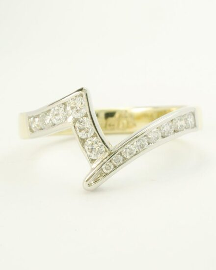 The single marquise diamond reset neater and showing off the stone to it's best and the shaped wedding ring remade as a far neater and finer channel set diamond ring.