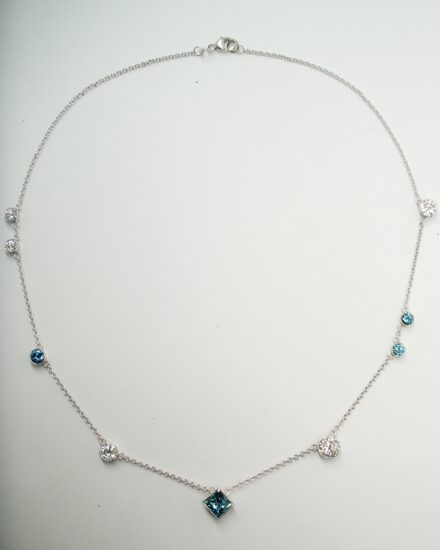 A 9 stone ocean blue and white Princess cut and round brilliant cut diamond necklace remodelled from a ring, pendant and pair of earrings.